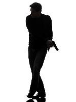 one man killer policeman holding gun walking silhouette studio white background