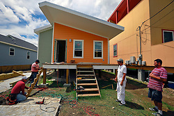23 August 2013. Lower 9th Ward, New Orleans, Louisiana.<br /> Katrina 8 years later. In a tale of two cities, the hardest hit neighbourhoods struggle to revitalize and return. Brad Pitt's 'Make it Right Foundation' enjoys limited success with ecologically sustainable housing rebuilds in a handful of city blocks. A few residents have also rebuilt their properties. Yet many half finished or blighted properties and vacant overgrown lots remain dotted throughout the landscape with limited new construction projects. Residents who have returned complain of limited services, infrequent police patrols, high crime rates, rampant mosquitos and uncontrolled vermin. <br /> Photo; Charlie Varley
