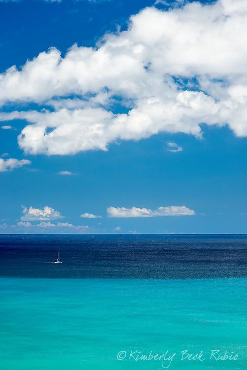 Tranquil day with a sailboat off the coast Waikiki on Oahu, Hawaii.
