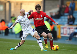 Millwall's Richard Chaplow battles for the ball with Barnsley's Paddy McCourt - Photo mandatory by-line: Robin White/JMP - Tel: Mobile: 07966 386802 23/11/2013 - SPORT - Football - Millwall - The Den - Millwall v Barnsley - Sky Bet Championship