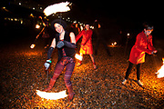 "Brighton, UK. Friday 21st December 2012. Fire show on the beach. Burning the Clocks has been a Brighton tradition for almost two decades. This event takes place on the winter solstice, the shortest day of the year. A 2,000-strong parade winds its way through the streets and people pass their handmade paper and willow lanterns – filled symbolically with their hopes and dreams – into a blazing bonfire to ""burn the clocks"" and welcome in the new longer day."
