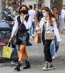 © Licensed to London News Pictures. 07/09/2020. London, UK. After the wind and rain, shoppers in Chelsea in South West London enjoy some warm weather as a mini heatwave is expected to hit the South East this week with temperatures predicted to reach up to 24c. Photo credit: Alex Lentati/LNP
