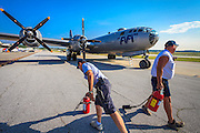 "Ground crew stand-by with fire extinguishers as ""Fifi"", the Commemorative Air Force's B-29 Superfortress, prepares to start her engines."