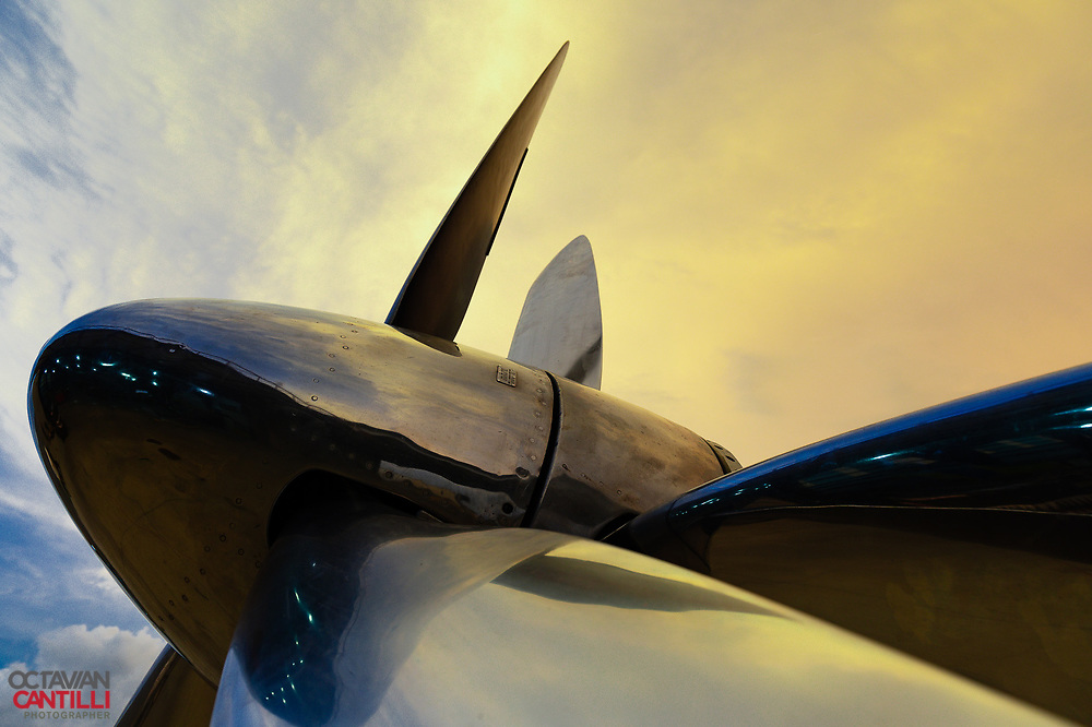 The custom made dual counterrotating props on Precious Metal lit by evening summer light.