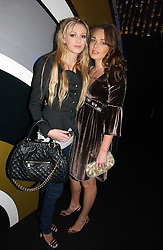 Left to right, PETRA ECCLESTONE and TAMARA ECCLESTONE daughters of Bernie Ecclestone at the launch party for the fashion label Javovich-Hawk held at the Fifth Floor Cafe, Harvey Nichols, Knightsbridge, London on 27th April 2006.<br />