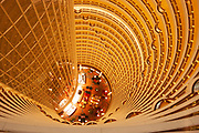 Atrium of the Grand Hyatt hotel, Pudong. This view taken from the 85th floor of the Jin Mao Building looks at the top section of this amazing tower which is owned by the Hyatt hotel group. Looking down, the bottom floor in this view shows the bar area on the 55th floor. This interior has become famous as one of Shanghai's tourist attractions, with many people paying to see the view from the viewing deck on the 87th floor. The symmetry and repetition of floors and balconies is breathtaking and visually overloading at the same time.