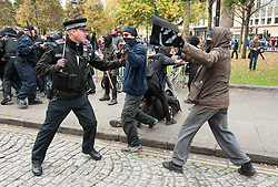 © Licensed to London News Pictures. 17/10/2015. Bristol, UK.  Violence between Anti-Fascists and police on College Green.  Bristol Patriots vs Anti-Fascists twin demonstrations in Bristol city centre.  The Bristol Patriots were marching against 'Somali rape gangs' and immigration, and the Anti-Fascists opposed them.  Violence flared between Anti-Fascists and police who made several arrests. Photo credit : Simon Chapman/LNP