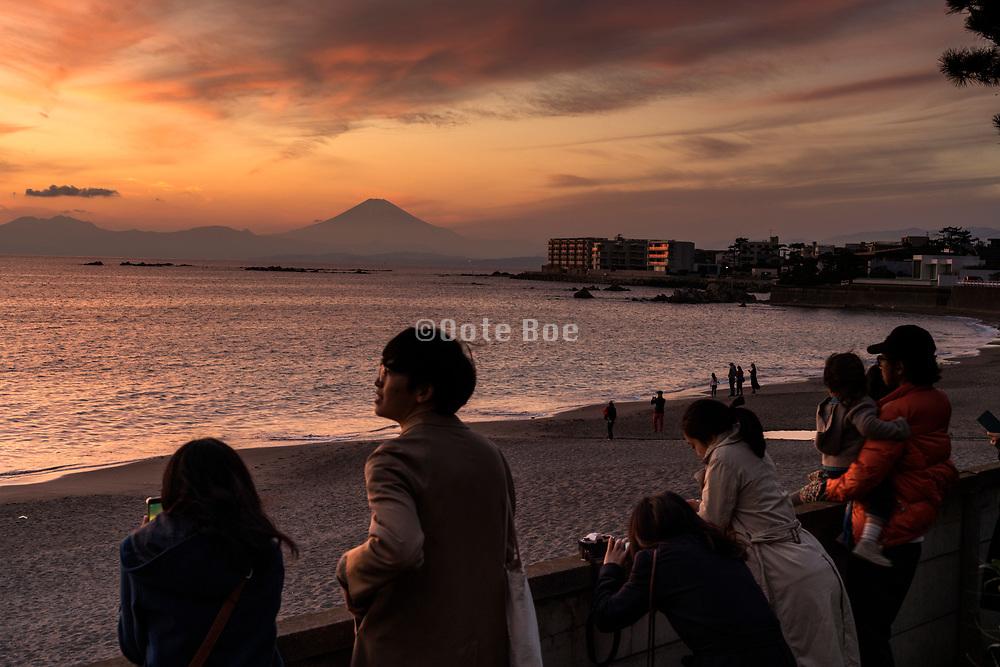 people watching the sunset with mounth Fuji near Kamkura Hayama Japan