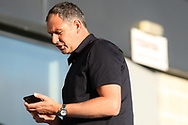Swansea manager Paul Clement checks his phone prior to kick off. Pre-season friendly match, Barnet v Swansea city at the Hive in London on Wednesday 12th July 2017.<br /> pic by Steffan Bowen, Andrew Orchard sports photography.