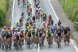© Licensed to London News Pictures. 16/06/2016. Church End, Ansley, Warwickshire, UK. The Aviva Women's Cycle Tour passing St Laurence's Church through Ansley in Warwickshire earlier today on the second stage of the race. Photo credit: Dave Warren/LNP