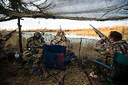 Hunters shooting at a duck while hunting in Shamrock, Oklahoma
