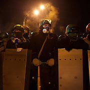 January 24, 2014 - Kiev, Ukraine: A group of protestors, armed with shields and batons, hold a defensive line in a standoff with riot police in a street surrounding Independence Square in central Kiev. (Paulo Nunes dos Santos)