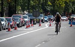 © Licensed to London News Pictures. 25/05/2020. London, UK. Traffic almost at a stand still on Park lane in central London at mid day on a bank holiday, where the bike lanes are being widened reducing the traffic to one lane. Government has encouraged the public to use bikes to travel rather than using public transport. Photo credit: Ben Cawthra/LNP