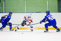 BOSTJAN GOLICIC of Slovenia between Yevgeniy Bumagin and Alexey Troshchinskiy  of Kazakhstan during Friendly Ice-hockey match between National teams of Slovenia and Kazakhstan on April 9, 2013 in Ice Arena Tabor, Maribor, Slovenia.  (Photo By Vid Ponikvar / Sportida)