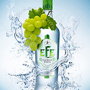 Bottle of EFE Raki sitting on ice with grapes draped over one side and liquid ladies floating around Ray Massey is an established, award winning, UK professional  photographer, shooting creative advertising and editorial images from his stunning studio in a converted church in Camden Town, London NW1. Ray Massey specialises in drinks and liquids, still life and hands, product, gymnastics, special effects (sfx) and location photography. He is particularly known for dynamic high speed action shots of pours, bubbles, splashes and explosions in beers, champagnes, sodas, cocktails and beverages of all descriptions, as well as perfumes, paint, ink, water – even ice! Ray Massey works throughout the world with advertising agencies, designers, design groups, PR companies and directly with clients. He regularly manages the entire creative process, including post-production composition, manipulation and retouching, working with his team of retouchers to produce final images ready for publication.