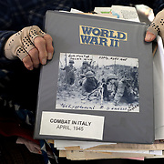 George Snyder, Jr., a 97-year-oldWorld War II veteran, holds up his binder at his Michigan Avenue home in Maumee, Ohio, on Thursday, Jan. 2, 2020. The binder contains photographs, newspaper clippings and other items relating to World War II and Snyder's service.Snyder survived combat and capture while serving in the Army in the 337th Infantry Regiment, 85th Infantry Division, Company G, in Italy. THE BLADE/KURT STEISS<br /> MAG WWIIVet01<br /> <br /> NOTE: This is one of my favorites from the set.