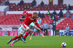 Lyle Taylor of Nottingham Forest breaks towards goal, pursue by Kyle Naughton of Swansea City  - Mandatory by-line: Nick Browning/JMP - 29/11/2020 - FOOTBALL - The City Ground - Nottingham, England - Nottingham Forest v Swansea City - Sky Bet Championship