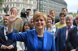 June 12, 2017 - London, London, United Kingdom - Image ©Licensed to i-Images Picture Agency. 12/06/2017. London, United Kingdom. Nicola Sturgeon meets new SNP MPs in Westminster.  Scotland's First Minister Nicola Sturgeon  join's the SNP's 35 MPs voted in from the 2017 general election. Also making a  statement setting out proposals for the Brexit negotiationsPicture by Andrew Parsons / i-Images (Credit Image: © Andrew Parsons/i-Images via ZUMA Press)