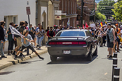 August 12, 2017 - Charlottesville, Virginia, United States - On Saturday, August 12, 2017, a veritable who's who of white supremacist groups clashed with hundreds of counter-protesters during the ''Unite The Right'' rally in Charlottesville, Va. Dozens were injured in skirmishes and many others after a white nationalist plowed his sports car into a throng of protesters.  One counter-protester died after being struck by the vehicle. The driver of the car was caught fleeing the scene and the Governor of Virginia issued a state of emergency. (Credit Image: © Michael Nigro/Pacific Press via ZUMA Wire)