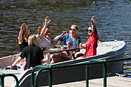 Friends wave as they leave dock on their hire boat during the 35th day of zero COVID-19 cases in Victoria, Australia. School and community sport is ramping up and as the weather improves, more people are venturing out and about to enjoy this great city. Pressure is mounting on Premier Daniel Andrews to keep his promise of removing all remaining restrictions. (Photo by Dave Hewison/Speed Media)