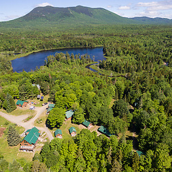 An aerial view of the Appalachian Mountain Club's Little Lyford Lodge and Cabins in Maine's 100 Mile Wilderness. Little Lyford Pond and Baker Mountain are in the background.