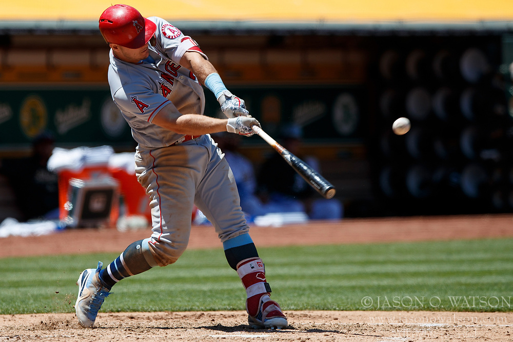 OAKLAND, CA - JUNE 17: Mike Trout #27 of the Los Angeles Angels of Anaheim at bat against the Oakland Athletics during the fifth inning at the Oakland Coliseum on June 17, 2018 in Oakland, California. The Oakland Athletics defeated the Los Angeles Angels of Anaheim 6-5 in 11 innings. (Photo by Jason O. Watson/Getty Images) *** Local Caption *** Mike Trout