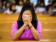 19 NOVEMBER 2017 - HWAMBI, YANGON REGION, MYANMAR: A woman prays in Sacred Heart's Catholic Church in Hwambi, about 90 minutes north of Yangon, before mass Sunday. Catholics in Myanmar are preparing for the visit of Pope Francis. He is coming to the Buddhist majority country November 27-30. There about 500,000 Catholics in Myanmar, about 1% of the population. Catholicism was originally brought to what is now Myanmar more than 500 years ago by Portuguese missionaries and traders.    PHOTO BY JACK KURTZ