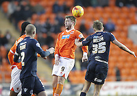Blackpool's Steven Davies jumps with Millwall's Sid Nelson<br /> <br /> Photographer Mick Walker/CameraSport<br /> <br /> Football - The Football League Sky Bet Championship - Blackpool v Millwall - Saturday 10th January 2015 - Bloomfield Road - Blackpool <br /> <br /> © CameraSport - 43 Linden Ave. Countesthorpe. Leicester. England. LE8 5PG - Tel: +44 (0) 116 277 4147 - admin@camerasport.com - www.camerasport.com