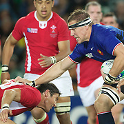 Imanol Harinordoquy, France, pushes off a tackle from James Hook, Wales, in action during the Wales V France Semi Final match at the IRB Rugby World Cup tournament, Eden Park, Auckland, New Zealand, 15th October 2011. Photo Tim Clayton...