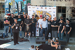 Cycle Source editor Chris Callen announces the winners of the In Motion Custom Bike Show (including the $10,000 first prize) on the main downtown stage at the Lone Star Rally. Galveston, TX. USA. Sunday November 5, 2017. Photography ©2017 Michael Lichter.