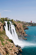 Turkey, Antalya, Lower Duden River as it plunges 40 meters into the mediterranean sea. Lara in the background,