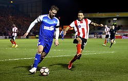 Nathan Arnold of Lincoln City closes down Luke Chambers of Ipswich Town- Mandatory by-line: Robbie Stephenson/JMP - 17/01/2017 - FOOTBALL - Sincil Bank Stadium - Lincoln, England - Lincoln City v Ipswich Town - Emirates FA Cup third round replay