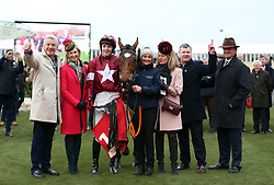 Tiger Roll ridden by Keith Donoghue and winning connections including Trainer, Gordon Elliot (second right) and Michael O'Leary (left) celebrate winning the Glenfarclas Chase during Ladies Day of the 2019 Cheltenham Festival at Cheltenham Racecourse.