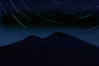 Russia, Caucasus. Star trails over Mount Elbrus, Europes highest mountain, 5642 m asl. 1 hour exposure time.