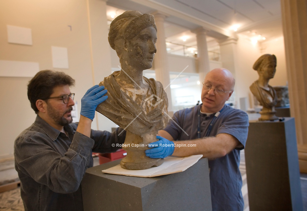John F Morariu Jr, left, and Fred Caruso transport the bust f a court lady onto it's new spot as workers are installing sculptures in Greek and Roman Galleries in preparation for opening which is several months away at the MET.  November 17, 2006. Robert Caplin For The New York Times. ...