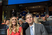 Eric Trump, son of GOP presidential nominee Donald Trump and his wife Lara Yunaska attend the second day of the Republican National Convention via live video link July 19, 2016 in Cleveland, Ohio. Earlier in the day the delegates formally nominated Donald J. Trump for president.