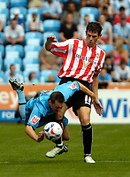 Photo: Ed Godden.<br /> Coventry City v Sunderland. Coca Cola Championship. 06/08/2006. Coventry's Michael Doyle (L) is tackled by Daryl Murphy.
