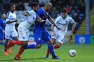 Calvin Andrew is challenged during the The FA Cup 2nd round match between Rochdale and Portsmouth at Spotland, Rochdale, England on 2 December 2018.