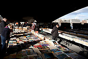 A walk along the River Thames on the Southbank in London. Second hand book stalls under Waterloo Bridge. Every day the books are laid out on these tables and in the evening the light illuminates them.This area is very popular especially on the weekends for Londoners to walk and see different arts, culture and entertainment.