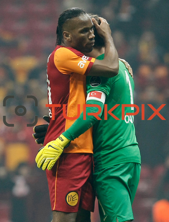 Galatasaray's Tebily Didier Yves Drogba (L) celebrate victory during their Turkish superleague soccer derby match Galatasaray between Trabzonspor at the AliSamiYen spor kompleksi TT Arena in Istanbul Turkey on Sunday, 22 December 2013. Photo by TURKPIX