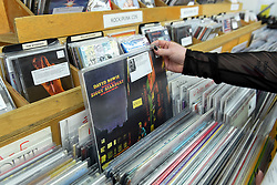 © Licensed to London News Pictures. 13/04/2019. LONDON, UK. A customer browses for David Bowie albums in Sounds of the Universe records shop. Analogue music fans visit independent record shops in Soho to celebrate vinyl music on the 12th Record Store Day.  Over 200 independent record shops across the UK come together annually to celebrate the unique culture of analogue music with special vinyl releases made exclusively for the day.  In 2018, sales of vinyl rose for the 11th consecutive year to 4.2 million units according to the British Phonographic Industry (BPI).  Photo credit: Stephen Chung/LNP