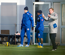 © London News Pictures. 30/11/2012. London, UK. QPR manager Harry Redknapp during training with QPR team players Adel Taarabt  and Sahun Wright-Phillips at the training ground in Harlington, Wes London. Photo credit: Ben Cawthra/LNP