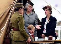 © Licensed to London News Pictures. 14/09/2012. Goodwood, UK 'A wartime family' People enjoy the atmosphere at the 2012 Goodwood Revival Meeting today 14 September 2012. Participants are encouraged to dress in period dress.. Photo credit : Stephen Simpson/LNP