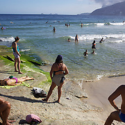A beach scene at the beachside rock pools and Arpoador beach,  Rio de Janeiro, Brazil. 4th July 2010. Photo Tim Clayton..