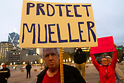 """Mark Collins from Cedar Hill Texas, holds a sign to protest President Trump's firing of Attorney General Jeff Sessions and naming Matthew Whitaker, a Trump loyalist to fill the position. The protest is part of the """"Red Line"""" nationwide protests prompted by the President's move to stop Special Counsel Robert Mueller's investigation into the WH."""