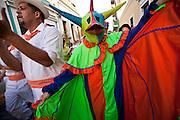 A costumed reveler during the Festival of San Sebastian in San Juan, Puerto Rico.