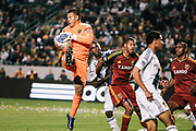 Real Salt Lake goalkeeper Nick Rimando, left, makes a save during the second half of their MLS soccer match against the Los Angeles Galaxy, Saturday, March 10, 2012, in Carson, Calif. Real Salt Lake won 3-1.(AP Photo/Bret Hartman)