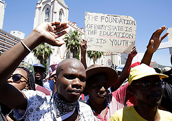 Students and supporters march to parliament in protest against higher education fees in South Africa on the 26th October 2016.  The students are protesting against the fees for higher education.  This protest is part of the #FeesMustFall campaign.<br /> <br /> Photo by Mark Wessels/ RealTime Images