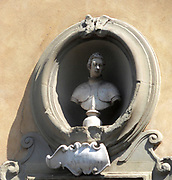Sculptural street detail from Florence, Italy. Relief stonework.