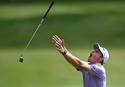 June 24, 2018 - Cromwell, CT, USA - Peter Malnati throws his club into the air on the 15th green during the final round of the Travelers Championship at TPC River Highlands in Cromwell, Conn., on Sunday, June 24, 2018. (Credit Image: © Brad Horrigan/TNS via ZUMA Wire)